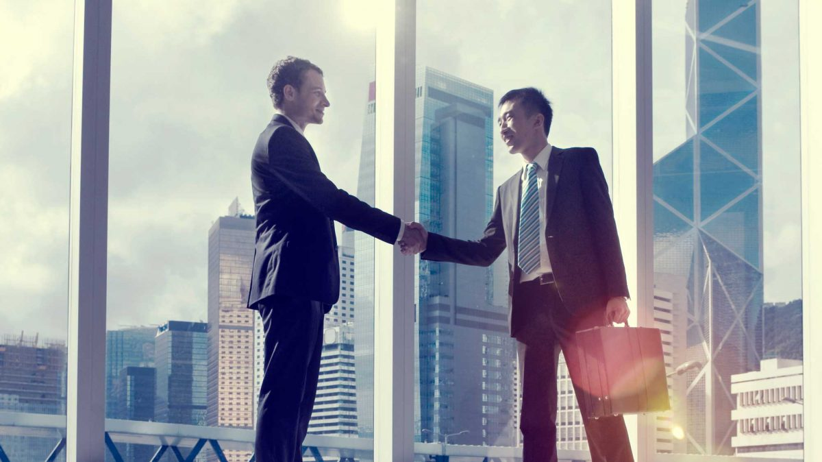 handshake in office building